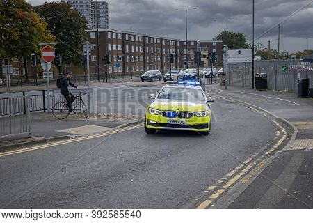 Doncaster, Yorkshire, England -  October 7, 2020. Police Car At High Speed In Pursuit  On A Cloudy D