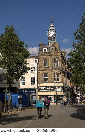 Doncaster, Yorkshire, England -  October 7, 2020. Clock Building Doncaster And People On The Street