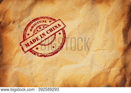 Made In China Stamp Printed On Crumpled Sheet Of Burnt Paper. Product Made In China, Parcel, Package