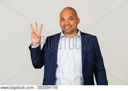 Portrait Of A Successful Young African American Businessman Guy, Showing With Fingers To Number Thre