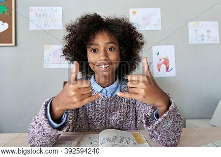 Happy African Deaf Mute Kid School Girl Learning Online Class On Laptop Looking At Webcam Communicat