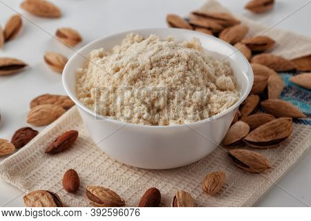 Almond Nuts And Almond Flour In A Plate Are On A White Table