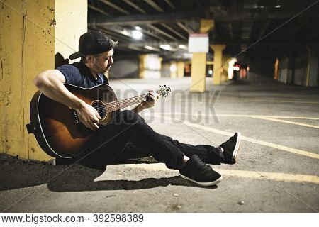 Man Guitar Player On Urban Scene In City Over Night