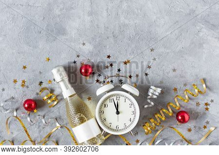 New Year Background With Golden Champagne Bottle, Confetti Stars And Party Serpentine Top View On Gr