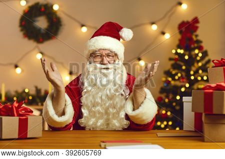 Happy Santa Claus Talking On Video Call With Kids Using Webcam On Laptop. Christmas Background.
