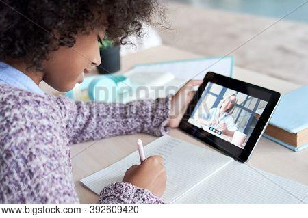 African Kid Child Girl Holding Digital Tablet Talking With Remote Teacher Tutor On Social Distance V