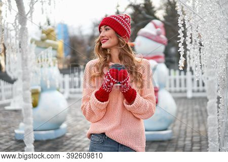 Beautiful Lovely Middle-aged Girl Curly Hair Warm Winter Sweater Red Knitted Hat Glove Stands Backgr