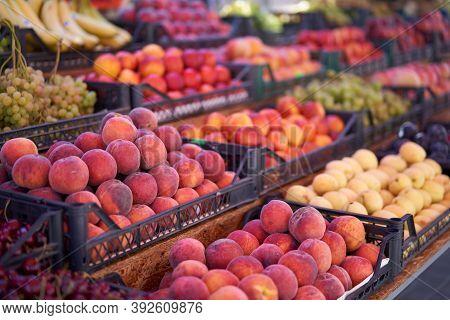 Fruit Bazaar Peaches Nectarine Grapes Apricots Ripe Juicy Lie Plastic Box Showcase. Seasonal Fruits