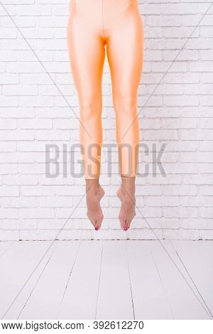 Feet Jump. Her Ambition Knows No Bounds. Ballet Dancers Feet. High Jump. Her Great Ambition Is To Be