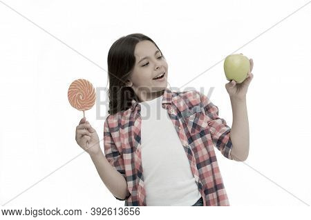 Healthy Alternative. Can Sugar Sweet Taste Make Us Happy. Girl Holds Sweet Lollipop And Apple. Schoo