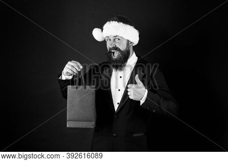 Christmas Advertising. Happy Manager Give Thumb Up To Shopping Bag. Advertising Holiday Gift. Holida