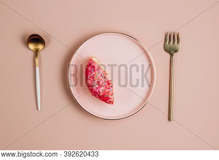 Intermittent Fastin Concept. One-third Donut Symbolizing Eight Hours With Cutlery On Pink Background