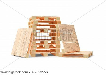 Heap Of Wooden Transport Or Freight Pallets With One Pallet Leaning Against It Over White Background