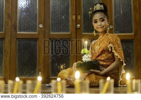 A Portrait Of A Young Student, An Asian Woman Wearing A Traditional Thai Dress To Portray Noppamas I