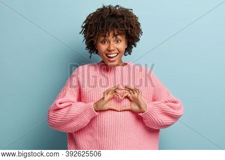 Positive Lady In Love Shows Heart Gesture Over Chest To Boyfriend, Expresses Affection, Thankful For