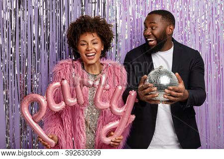 Photoshoot Before Having Party. Joyful Ethnic Woman And Man In Stylish Outfit, Have Fun On Disco, Or