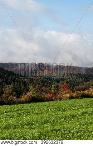 View Over Agricultural Field To Wooded Hills In Swabian Alb On A Sunny Morning In Autumn With Rising