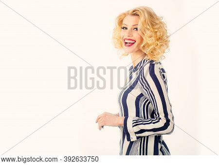 High Fashion Model Woman Posing In Studio. Young Smiling Woman Dressed In Pin-up Style