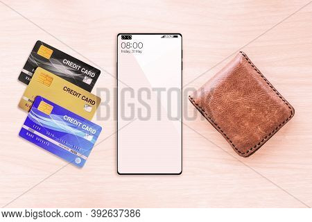 Top View Of Wallet Smartphone And Credit Cards On Wood Table Background.