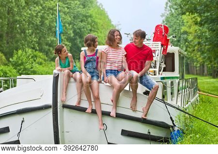Family Vacation, Summer Holiday Travel On Barge Boat In Canal, Happy Kids And Parents Having Fun On