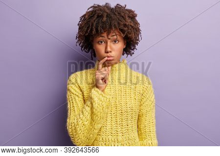 Sad Woman With Curly Hair, Purses Lower Lips With Displeasure, Looks At Camera With Discourage, Dres