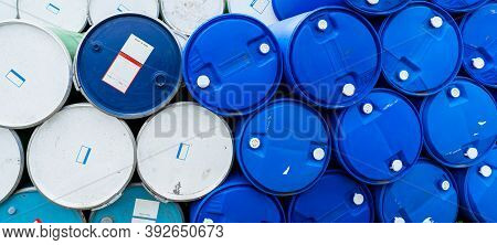 Old Chemical Barrels. Blue And Green Oil Drum. Steel And Plastic Oil Tank. Toxic Waste Warehouse. Ha
