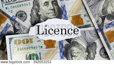 Usa Dollar With Finance Text Licence On The Torn Piece Paper