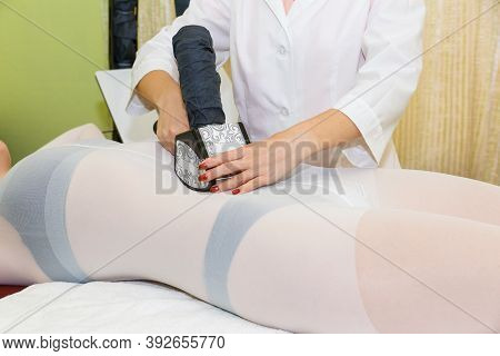 Anti-cellulite Massage Procedure With Modern Lpg Technology In The Massage Room. A Young Woman Lies