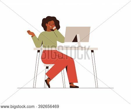 African American Female Is Talking Phone And Looking At The Computer. Business Woman Or Freelancer W