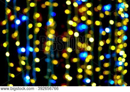Blurred Christmas Background Of Blue And Yellow Bokeh Lights And Lanterns, New Year