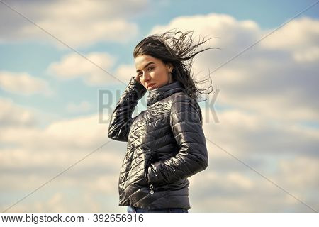 Girl Spring Jacket Blue Sky Background. Woman Fashion Model Outdoors. Beauty And Fashion Look. Feel