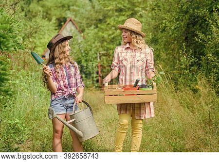 Gardener Occupation. Taking Care Of Plants. Cute Gardener Concept. Loving Nature. Sisters Helping At
