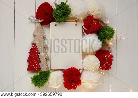 Christmas And New Year Mockup.christmas To-do List. Notebook, White,red And Green Woolen Pom Poms,sh