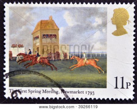 a stamp printed in Great Britain shows The First spring meeting Newmarket painting by J.N. Sartorius