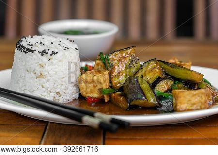 Lightly Fried Tofu And Stew With Eggplant, Onion, Garlic, Gravy Sauce On Plate