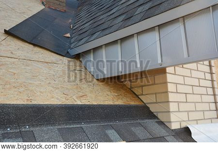 A Close-up On Unfinished Attic Roofing Construction With Fascia Board And Plywood Sheathing Covered