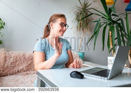 Middle Age Woman Sitting At The Table At Home Working Using Computer Laptop. Work From Home During C