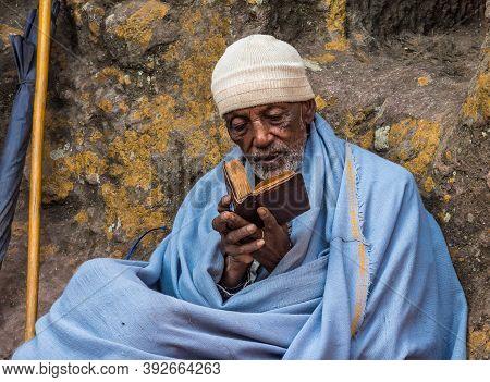 Lalibela, Ethiopia - Feb 13, 2020: Ethiopian People At The Famous Rock-hewn Church Of Saint George -