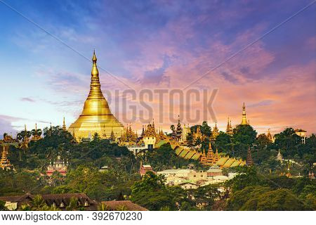 Shwedagon Pagoda is the most sacred golden Buddhist temple in Myanmar.  It is located on the Singuttara hill in Yangon, Myanmar. Sunrise time on this picture
