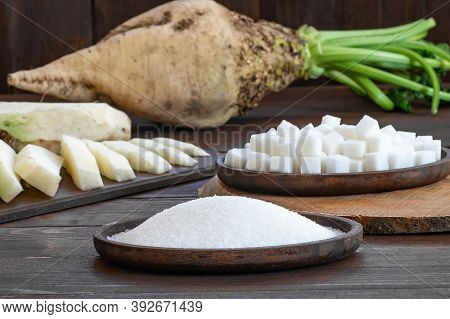Granulated And Cube Sugar In Bowl With Fresh Raw Sugar Beetroot On Wooden Table, Beta Vulgaris