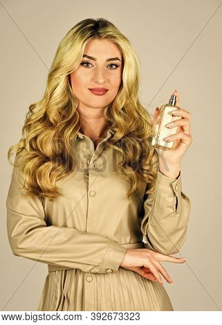 Gourmet Composition For Women. Attractive Woman In Fashionable Leather Dress Hold Perfume Bottle. En