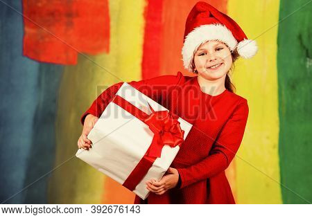 Best Holiday. Small Santa Helper. Cheerful Kid Hold New Year Present. Gift Box And Parcel Delivery.