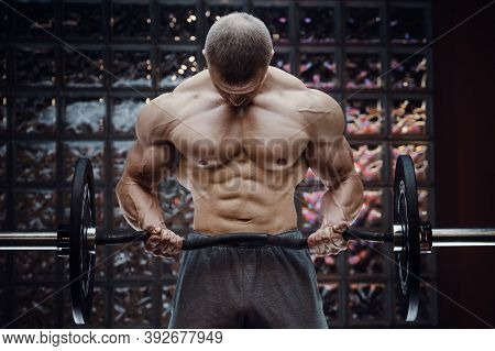 Fitness Man Pumping Up Arm Muscles. Fitness Workout And Bodybuilding Healthy Concept Background. Bod