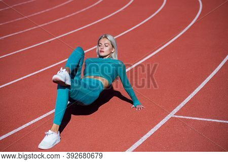 Sporty Beauty. Athletic Lady Stretching At Stadium. Female Athlete Ready For Sport Workout. Trainer