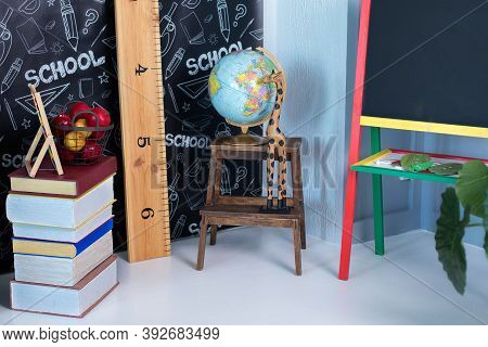 Interior Of Elementary School. Chalkboard, Book, Globe And Stationery On Classroom. Teachers Day Con