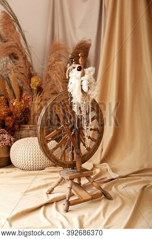 Vintage Machine Tool - Spindle, A Device For Hand Spinning Yarn. Old Wooden Spinning Wheel With Yarn