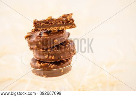 Chocolate Biscuit Sandwich In Chocolate And Nut Glaze On Christmas Background