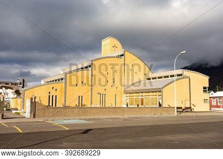 Isafjordur, Iceland - July 7, 2014: Yellow Isafjardarkirkja Church With Unusual Architecture Design