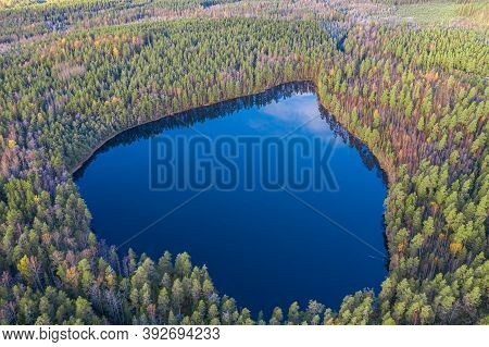 Heart-shaped Lake With Blue Water And Green And Dense Pine Forest. Photo From The Drone. Finland, La