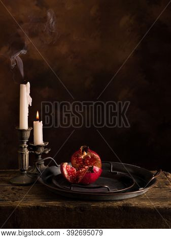Still life with pomegranate and candles